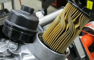A smashed/twisted/deformed filter element can also prevent the drain check valve from closing.