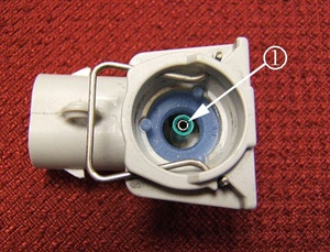 Inspect the center post and green insulator of the connector for damage.