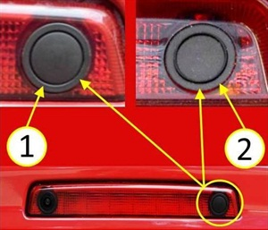 The plastic and rubber switch buttons appear very similar. Carefully inspect to determine if the button is plastic (1) or rubber (2).