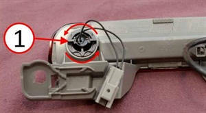 Remove the passive entry switch form the CHMSL housing. Note: On LX vehicles the passive entry switch may be replaced without removing the center high mounted stop lamp from the decklid.