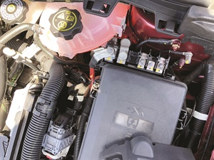 Battery power jump/inspection terminals are located at the rear of the fuse junction block.