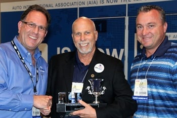 The award was presented by AIA Chairman Ira Davis (center) and accepted by Centric Parts president and CEO Dan Lelchuk (left), and Vice President Product Management and Catalog, Brian Griffin III (right).