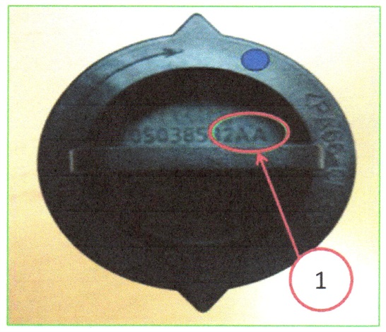 The part number is visible on top of the PCV valve.