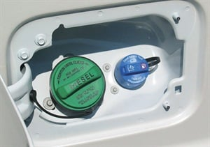 Ford F-Series trucks feature the DEF fill point alongside the diesel fuel fill point (green cap for diesel and blue cap for DEF).