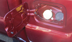 Ford F-Series trucks (model 2010 and later) share the same quarter panels in both gas and diesel applications. Shown here is a gasoline-powered Ford F-Series fuel fill point. Notice the plugged-off (unused) location to the right of the fuel cap.