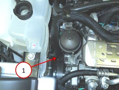 Note the potential interference between the coolant reservoir hose and the belt or pulley.