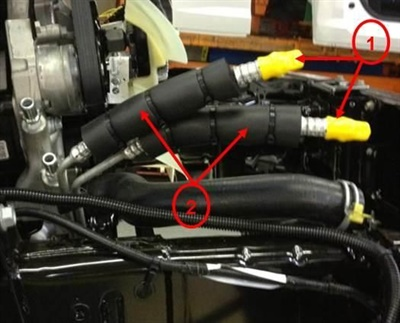 Install the foam sleeves with zip ties to the transmission cooler lines as shown.