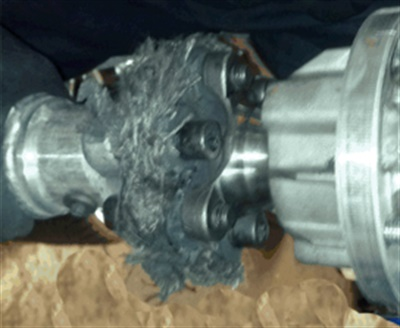 Inspect the torque tube coupling for damage.