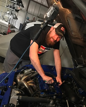 """Derek Fetter, a technician from Troy, Mo., won $5,000 in the """"Off the Track"""" category."""