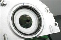 The General Motors LS engine one-piece rear seal is installed to the engine's rear cover, with the nylon guide in pace.