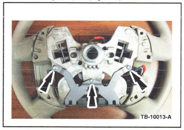 Revised steering wheel damper. Note the location of the three damper screws.