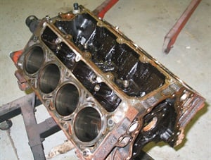 More frequent oil changes will dramatically reduce the chance of dealing with a sludge-monkey like this ill-maintained GM 5.3L.