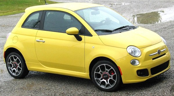 The new 2012 Fiat 500 features a 1.4L four-cylinder engine, FWD and averages between about 38-40 MPG. The tiny four-banger offers surprisingly responsive performance.
