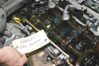 The worn-out, heat-cooked oil in this engine turned to a pasty, gummy, gritty goo that simply offered no hydraulic film support. The simple and inexpensive task of changing the oil on a regular basis would have avoided the issue. Oil sludge and resulting starvation resulted in a broken overhead cam in this example, where the cam simply could not withstand the stresses imposed by a lack of flowable oil.