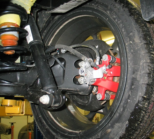Rear disc brakes feature integrated parking brake operation.