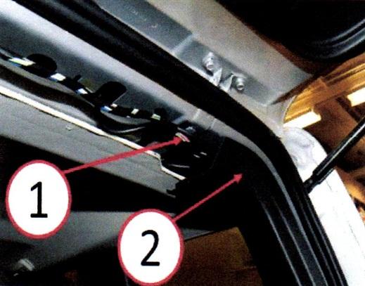 Figure 1: Rear headliner trim panel location. 2) Inner quarter trim panel.