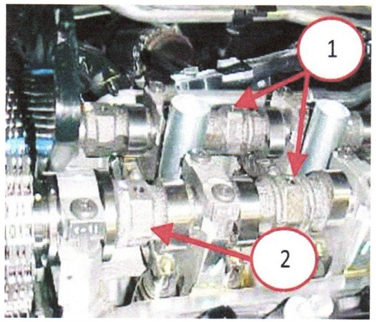 Rotate the camshaft until the two datum holes in the camshaft are pointing up.