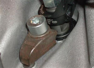 Inspect each injector hold-down clamp for a broken ear.