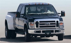 If the 6.4L Ford diesel produces white smoke under throttle, a revised charge air cooler may be needed.