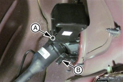 Plug the fuel tank filler pipe housing drain hole using clear silicone rubber. Install a fill pipe drain tube.
