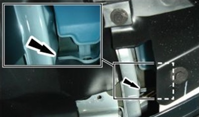 Note the clearance required between the reservoir mounting bracket and the body rail.