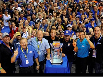 Front row, L to R: Willie B., Two Guys Garage; Rusty Bishop; Sam Bass; Frank Stoddard, team owner, FAS Lane Racing; Kenny Schrader; Dennis Bickmeier, president, RIR; Kevin Byrd, Two Guys Garage