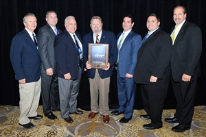 (L to R): The SMP team with Federated CEO Rusty Bishop: Leon De Long, Phil Hutchens, Ken Wendling, Bishop, Eric Sills, Joe Donaggio and Bill Collins.
