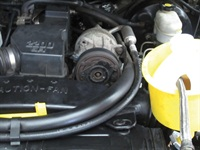 Figure 1: Placing a coolant funnel on the radiator serves as a tent to allow the five-gas probe to pick up any fumes running through the cooling system.