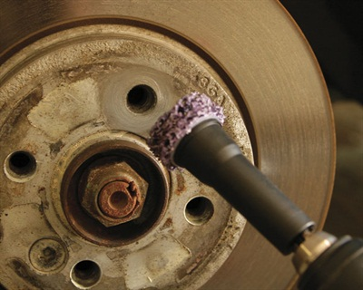 Figure 1: Clean the rotor hub where it contacts the wheel and fits through the wheel center.