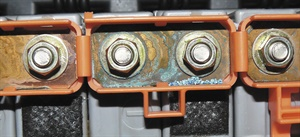 Note that corrosion at the battery module terminals can cause uneven charging and discharging that will set a battery fault code.
