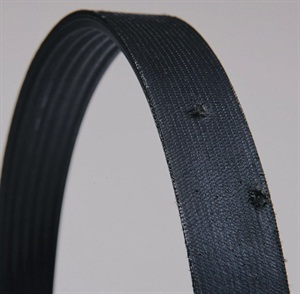 Gravel or other hard debris can actually be forced through a drive belt, with resulting damage to the internal structure.