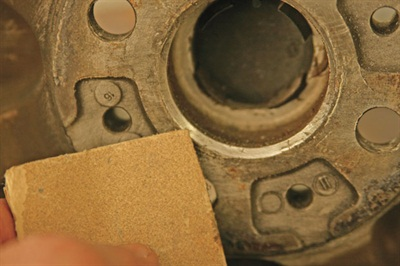 Figure 2: Clean the chamfer on the wheel's center bore with sandpaper or a brush.