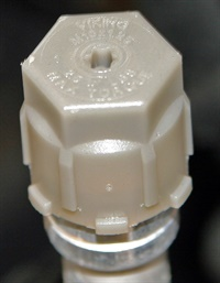 The service port caps are supposed to be tethered to avoid loss during service. The caps on this 2017 Chevrolet Malibu don't have tethers, but they do have an O-ring inside to keep the service port clean. Tethers are available as service parts.