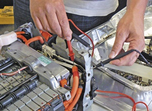 Leaking electrolyte or moisture in the vehicle's battery tray can create a path to chassis ground, setting code P3009.
