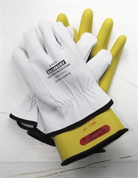Lineman's gloves must be worn when removing or installing the battery service plug or the battery itself. Even a pinhole is enough to render the gloves ineffective, so leather gloves are worn over the rubber lineman's gloves to protect them from damage.
