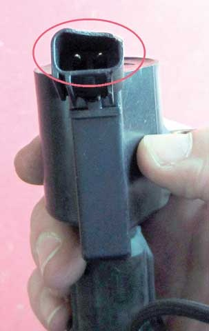 Figure 1: The infamous 2000's era Ford ignition coil. Circled is the primary connection section of this troublesome coil design.
