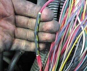 Figure 4: Compare Figures 4 and 5, which are the suspect splice, and Figure 6 (seen on page 36), a known good wiring splice. We thought we had nailed our culprit.
