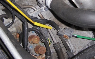 Figure 7: Here, on a different vehicle, the tech is checking to see if 5 V can be measured at the heater circuit wire.
