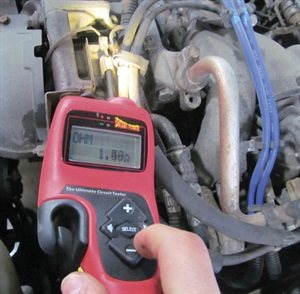 Here, a Power Probe Hook is being used to test an A/C compressor.