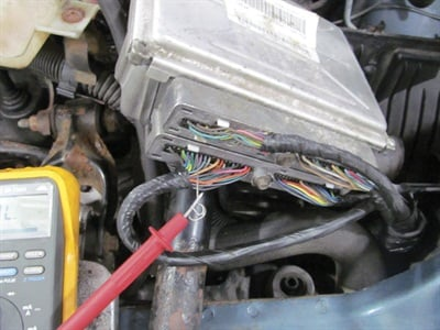 Figure 8: Backprobing a PCM is as easy as finding the right colored wire from the wiring diagram and sticking a T-Pin into where the wire connects into the back so no insulation has to be broken. Breaking insulation can lead to corrosion in the wiring in the long term.