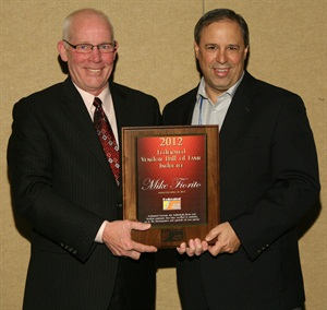 Larry Pavey (left), president of Federated Auto Parts, presents Mike Fiorito (right), vice president of KYB Americas Corp., with the 2012 Federated Auto Parts Vendor Hall of Fame award.