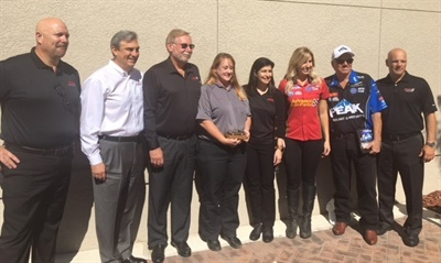 Advance Auto Parts CEO Tom Greco (second from left) was joined by Courtney Force and John Force of John Force Racing (third and second from right, respectively) in Fort Myers, Fla., for a recent visit to meet with team members and champion the company's hurricane relief efforts.