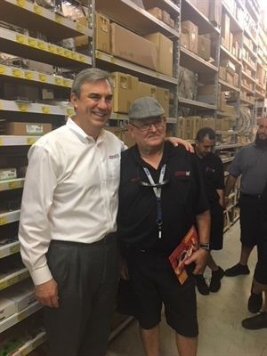 Advance Auto Parts team member Rene Camps (right) poses for a photo with Tom Greco, president and CEO at Advance.