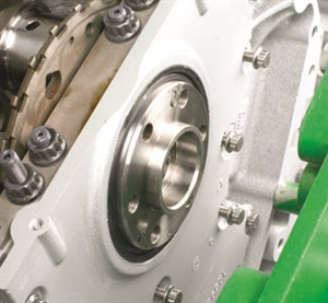 As the rear engine cover is installed, the nylon seal guide centers the seal to the crankshaft flange and falls out once the seal engages. This prevents the seal lips from peeling rearward.