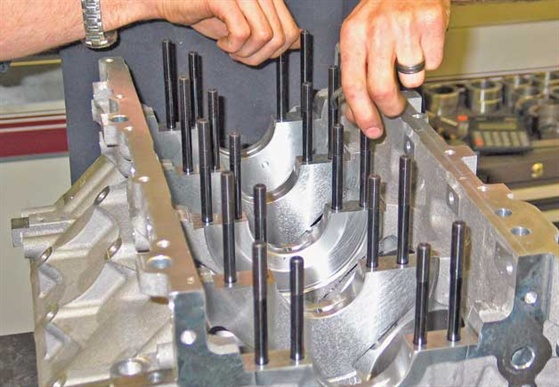 Here a set of main studs is installed finger-tight into a GM LS block.