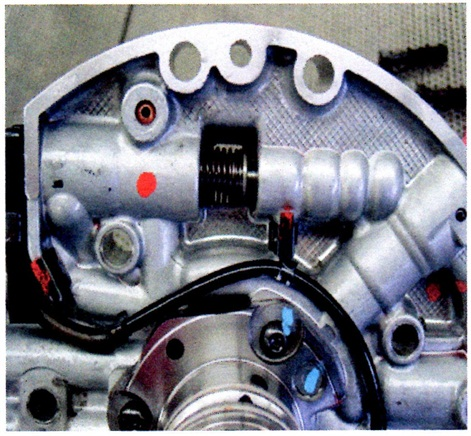 The pressure regulator valve may be sticking in its bore. Check line pressure and bore finish.