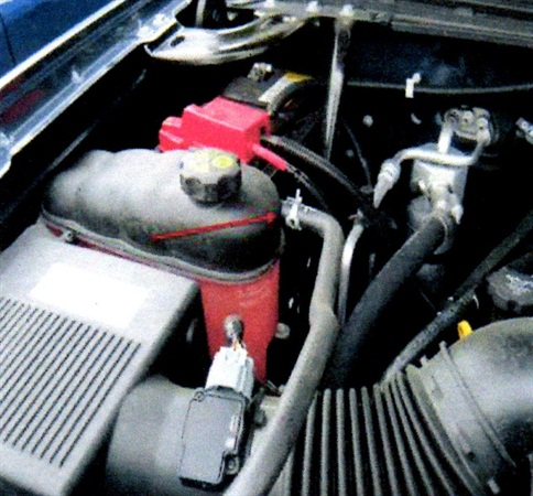 Look for traces of coolant leak at the hose-to-coolant overflow tank nipple.