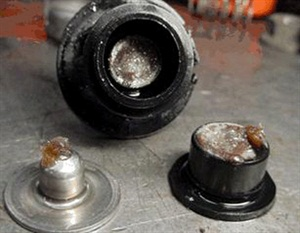 Fuel pressure regulator contaminated with DEF (diesel exhaust fluid).