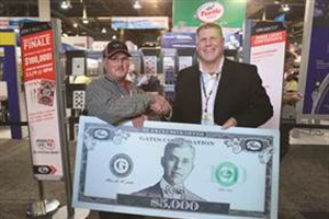 Charles Foreman (left), the winner of the Gates Deal of the Century at AAPEX 2015, is pictured with Scott Howat, director of marketing and product management for Gates.