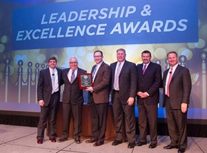 Gates executives accept the company's award from NAPA, from left to right,Byron Frantz, vice president of wholesale product management at NAPA; Dave Carroll, president of the Americas at Gates; Jack Ramsey, senior vice president of the automotive aftermarket at Gates; Scott Howat, director of sales and marketing at Gates; Mike Gordon, general manager at Gates; and Scott LaProhon, executive vice president of merchandising and product strategy at NAPA.